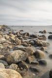 Rocky Shoreline over Ocean Royalty Free Stock Photos