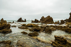 Rocky Shoreline. Section of the jagged rocky shoreline of Laguna Beach, California Stock Photos