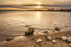 Rocky Shoreline Sunset Stock Photos