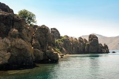 Rocky shoreline in Turkey. Big rocks and cliffs at the shoreline Royalty Free Stock Images