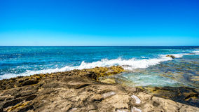 The rocky shoreline of the west coast of the island of Oahu Stock Photography