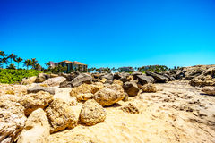 The rocky shoreline of the west coast of the island of Oahu at the resort area of Ko Olina Stock Photo