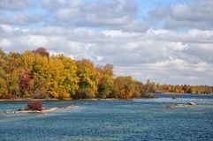 Rocky shorelines. A fall tour of a lakeshore with the fall colours Stock Photos