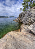 Rocky shores of Coeur d'Alene Lake. Stock Image