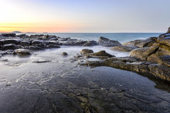 Rocky Shores Mooloolaba Queensland Australia. Long exposure taken at sunset in Mooloolaba which is a suburb and tourist resort township on the Sunshine Coast of royalty free stock photo
