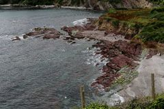 Rocky Shores at Talland Bay. The rocky shores of Talland Bay in Cornwall Stock Image