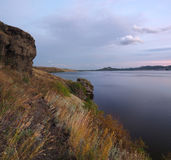 The rocky side of the Bannoye lake at the dusk after sunset Stock Photo