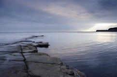 Rocky Slate Ledges at Kimmeridge. Slate ledges revealed at low tide in Kimmeridge Bay on the Jurassic coastline of Dorset Stock Images