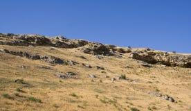 Rocky slope. Rocky hillside on the background of blue sky Stock Image