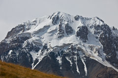 Rocky slope of mountain peaks, glaciers, snowfields Stock Image