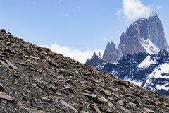 Rocky slope and mountain peaks with snow Royalty Free Stock Images