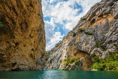 The rocky slopes of canyon Verdon. Mercantour National Park, Provence. The rocky slopes of canyon Verdon descend into azure water of the river Royalty Free Stock Photos