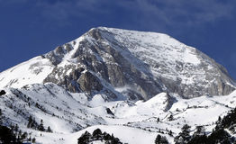 A rocky and snow-capped mountain top Royalty Free Stock Photos