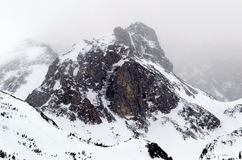 A rocky and snow-capped mountain top Royalty Free Stock Image