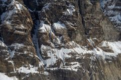 Rocky Snow Covered Cliff Face. A beautiful Rocky Snow Covered Cliff Face background stock photography