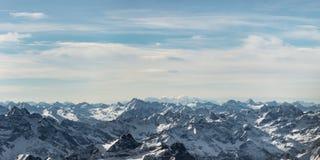 Rocky snowy mountain peaks. In austria with blue cloudy sky stock photos