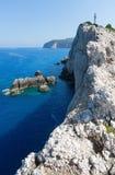 Rocky cape of Lefkas island (Greece). Rocky south cape of Lefkas island and lighthouse (Greece, Ionian Sea Stock Image