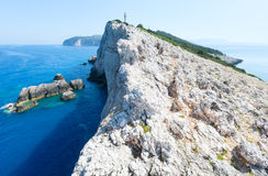 Rocky cape of Lefkas island (Greece). Rocky south cape of Lefkas island and lighthouse (Greece, Ionian Sea Royalty Free Stock Images