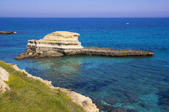 Rocky stacks on the coast of Salento in Italy. Rocky stacks of Santo Andrea on the sea of Salento in Puglia in Italy Stock Photography