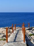 Rocky stairs. And the sea Royalty Free Stock Photos