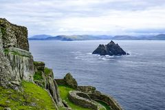 Rocky steep Little Skellig Island in the Atlantic Ocean, off of Ireland, as seen from Skellig Michael Island, larger of the two.