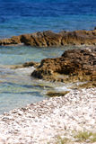 Rocky stone beach in island Susak,Croatia Royalty Free Stock Images