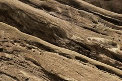 Old rock and mineral background texture on a wall. Rocky stone and mineral natural background texture royalty free stock photo
