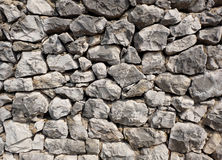 Rocky stone wall background texture - large natural rocks royalty free stock photo