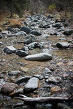 Rocky stream. Rocks and boulders in a small brook or stream in Devils Punchbowl, California Royalty Free Stock Photography