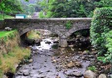 Rocky stream and bridge royalty free stock photography