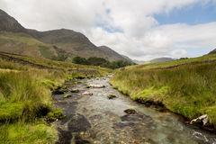 Rocky stream leads towards Buttermere Royalty Free Stock Images