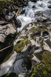 Rocky stream, motion blurred water Stock Images