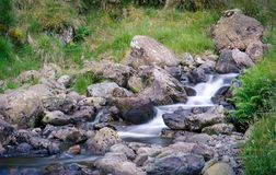 Free Rocky Stream On A Slope Stock Image - 137034141