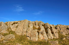 Rocky summit. Rock feature and deep blue sky on summit of Dunmore, Scotland Stock Photography