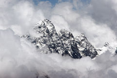 Rocky summit sticking out of clouds, Himalaya Royalty Free Stock Photography