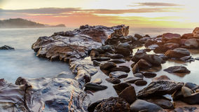 Rocky Sunrise Seascape. Taken at Avoca Beach, Central Coast, NSW, Australia Stock Image