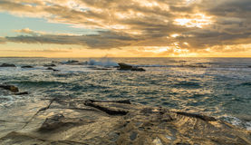 Rocky Sunrise Seascape. Taken at Blue Bay, Central Coast, NSW, Australia Stock Photo