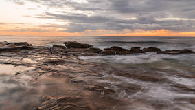 Rocky Sunrise Seascape. Watching the sun come up at Blue Bay, Central Coast, NSW, Australia Stock Photos