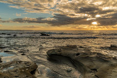 Rocky Sunrise Seascape. Watching the sun come up at Blue Bay, Central Coast, NSW, Australia Stock Images