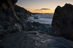 Rocky Sunrise. View along a rocky New England beach at sunrise Royalty Free Stock Photo