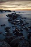 Rocky sunset. Sunset on the rocky sea Stock Photos