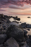 Rocky sunset. Rocky seaside and beautiful sunset Stock Image