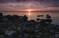 Rocky sunset. Rocky seaside and beautiful sunset Royalty Free Stock Photography
