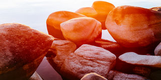 Rocky sunset. A sun glare into my lens at sunset colored everything orange Royalty Free Stock Photo