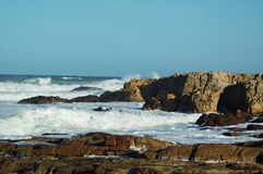 Rocky surf. Indian ocean waves breaking over a rocky shore Stock Photography