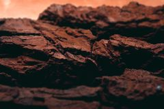 Rocky surface of the planet mars with visible valleys. And mountains. Red colour of the ground with details Stock Photos