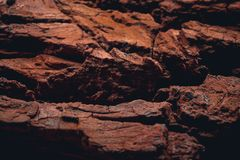 Rocky surface of the planet mars with visible valleys. And mountains. Red colour of the ground with details Royalty Free Stock Photos