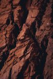 Rocky surface of the planet mars with visible valleys. And mountains. Red colour of the ground with details Stock Photo