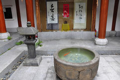 Rocky tank. Chinese style building house has a big tank zun stone Chambers Royalty Free Stock Images