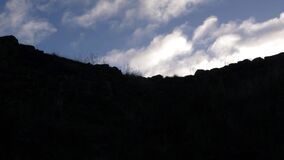 Rocky terrain with blue skies and clouds